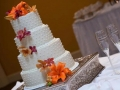 Four tier white wedding cake with flowers
